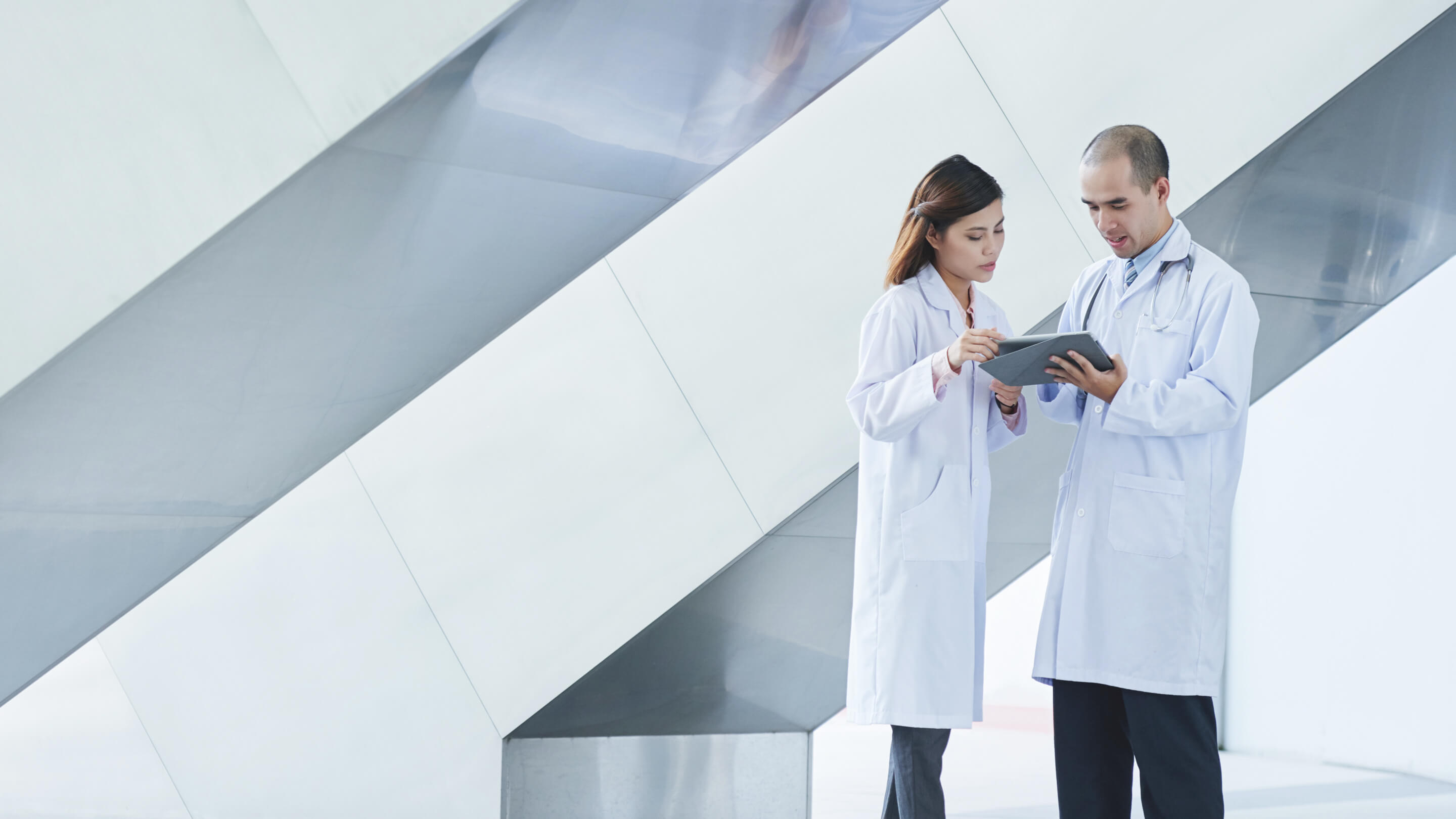 two healthcare professionals looking at chart