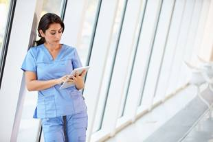 healthcare professional looking at tablet