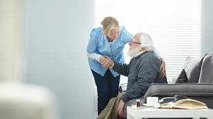 caregiver taking care of elderly