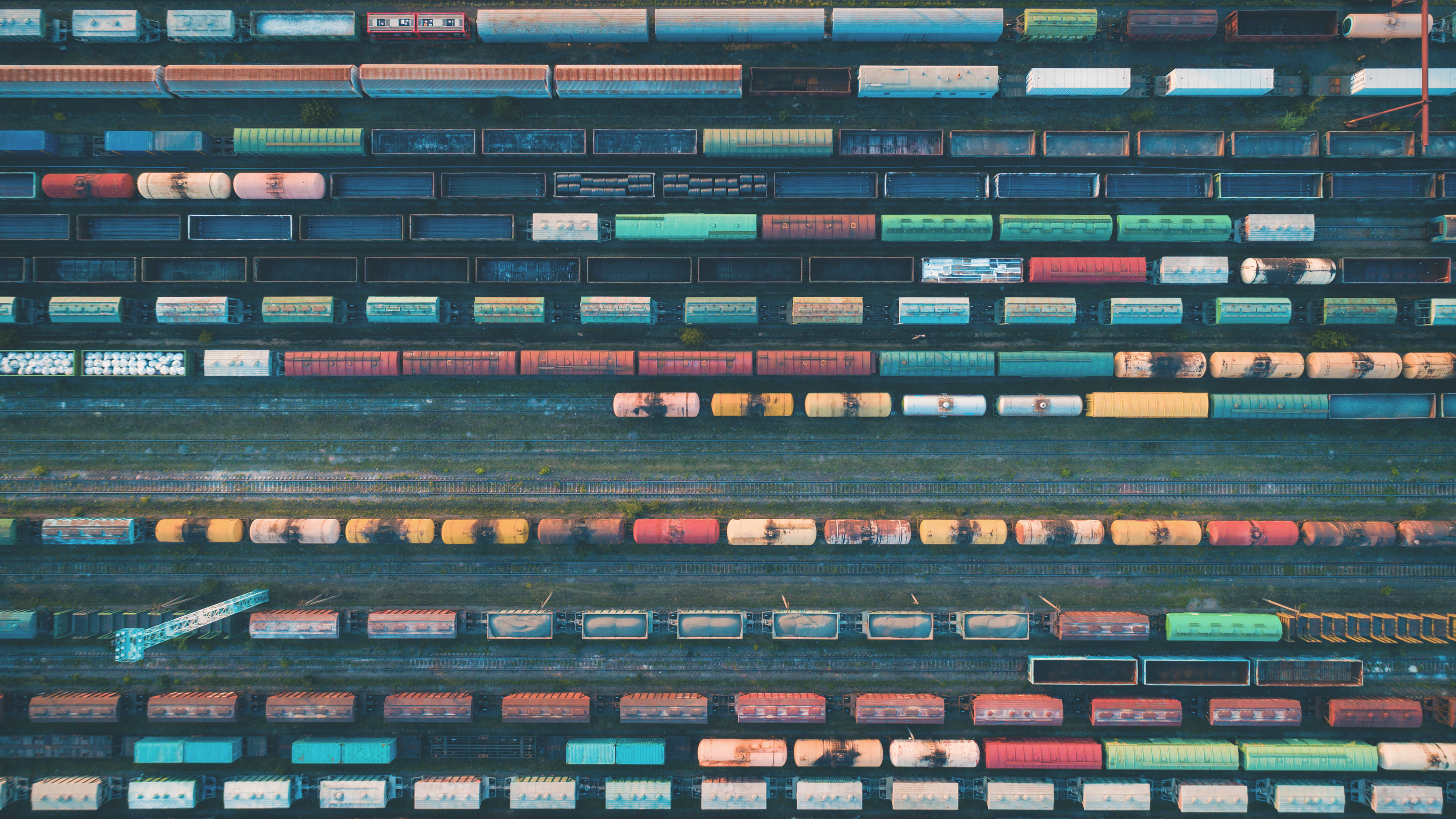 looking down from a distance at railroad transport cars