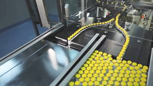 caps being put on in automated machine