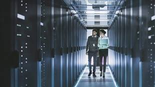 two people walking through data centre