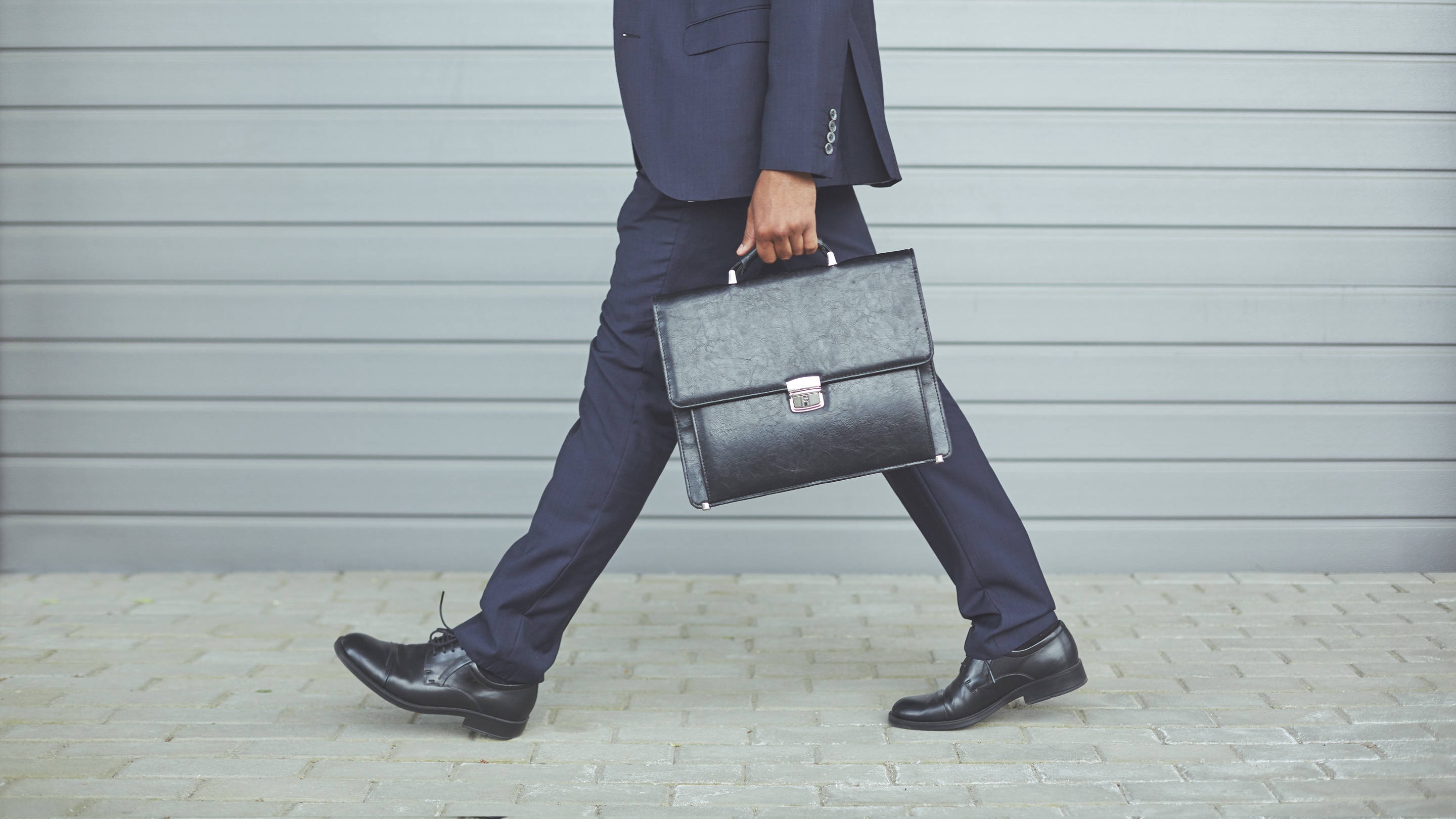 man walking with soft briefcase