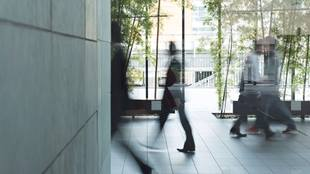 blurred photo of people walking in lobby