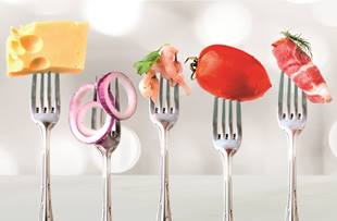 Various foods on forks