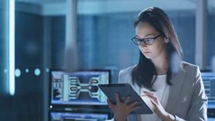 woman working with tablet and computers