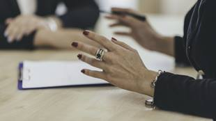 womans hands in meeting